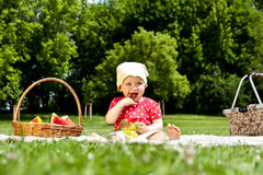 Baby On Picnic With Fruits Royalty Free Stock Photos