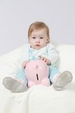 Baby and piggy bank Stock Photos