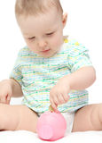 Baby with piggy bank Stock Image