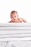 Baby on pile of towel Royalty Free Stock Images