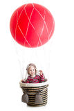 Baby with pilot hat on hot air balloon Royalty Free Stock Images