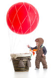 Baby with pilot hat on hot air balloon Stock Image