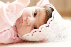 Baby in pink Stock Images