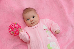 Baby on pink blanket. Baby playing on a pink blanket Stock Image
