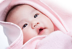 Baby with pink blanket Stock Images