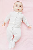 Baby on the pink blanket. Caucasian baby laying down on the pink blanket. Vertical shot Stock Photography