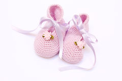 Baby pink booties. Baby pink knitted booties  on white Royalty Free Stock Images