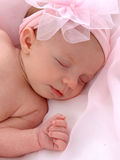 Baby with Pink Bow. Closeup of sleeping baby with pink bow Stock Image
