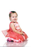 Baby in pink dress Stock Photo