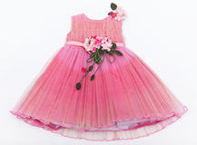 Baby pink dress with a bouquet on the belt Stock Photos