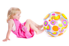 Baby in pink dress playing with coloful ball. Over white royalty free stock image