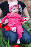 Baby in a pink dress Stock Photography
