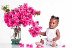 Baby with pink flowers Royalty Free Stock Photography
