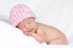Baby with pink hat Stock Images