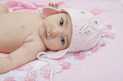 Baby in pink hat. Cute little baby in an amusing pink hat Stock Photos