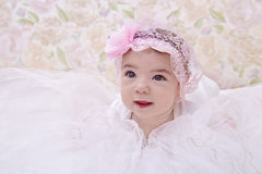 Baby in pink hat looks up Royalty Free Stock Photos