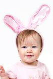 Baby with pink rabbit ears Royalty Free Stock Image