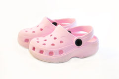 Baby pink rubber summer shoes. Stock Photo