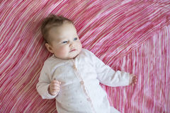 Baby on pink sheet. Adorable baby on pink sheet Stock Photo