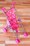 Baby pink stroller Royalty Free Stock Images
