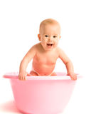 Baby in a pink tub for bathing  Stock Image