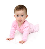 Baby in pink on white sheet Stock Photography