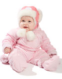 Baby in pink winter clothes. Smiling baby in pink winter clothes, isolated Royalty Free Stock Image