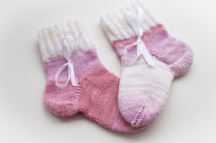 Baby pink wool socks with a bow. S Stock Images