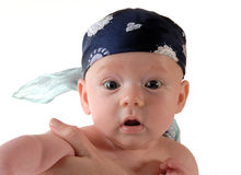 Baby pirat. Baby with head clothes Stock Images