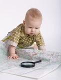 Baby planning travel with map on white Stock Photos