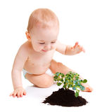 Baby with plant Royalty Free Stock Photo