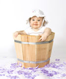 Baby in planter Stock Image