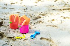 Baby plastic bucket with toys on sandy seaside Royalty Free Stock Images