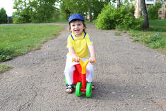 Baby on plastic run bike outdoors Royalty Free Stock Photo