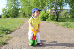 Baby on plastic run bike outdoors in summer Royalty Free Stock Photos