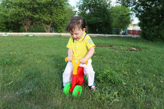 Baby on plastic run bike in summer Royalty Free Stock Photography