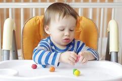 Baby with plasticine Stock Photos