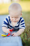 Baby play with bright toys Stock Photos