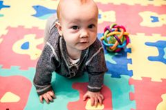 Baby play and crawling Royalty Free Stock Photo