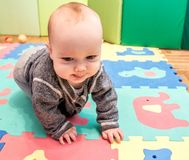 Baby play and crawling. Cute male baby stock photography