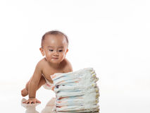 Baby play with diaper. Baby is playing with a pile of diaper Stock Photos