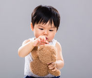 Baby play with the doll bear Royalty Free Stock Images
