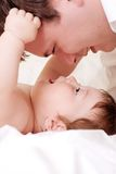Baby play with father. Close portrait of beautiful baby play with father Royalty Free Stock Image