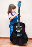 Baby play on guitar Royalty Free Stock Photography