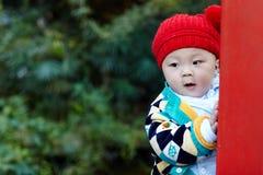 Baby play hide and seek. Cute baby boy play hide and seek Royalty Free Stock Photos