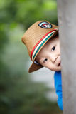 Baby play hide and seek. Cute baby boy play hide and seek Royalty Free Stock Photography