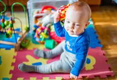 Child baby boy play. Baby play in his room, cute male baby boy, 8 month old Royalty Free Stock Photo