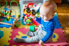 Baby play in his room with lots of toys Royalty Free Stock Image
