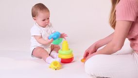 Baby play with mother stock video