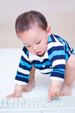 Baby play  PC Keyboard Stock Photo